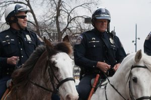 Officers Jimmy Parent and Ed Zehner dismount for the final time